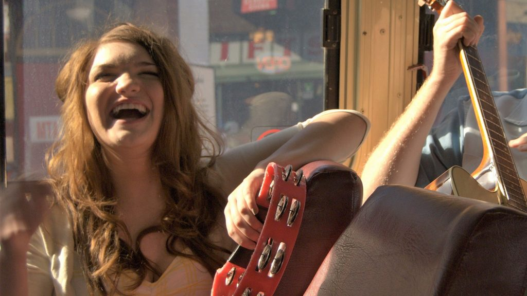 Woman laughing in tour bus